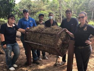Zoo keepers building enrichments for animals in a Thai zoo