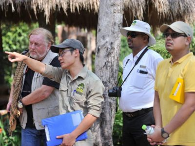 Wild Welfare field director stands with zoo staff in a Vietnamese zoo conducting a welfare audit